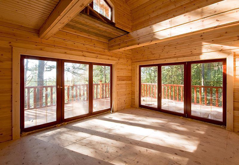 Какие установить окна в деревянном доме